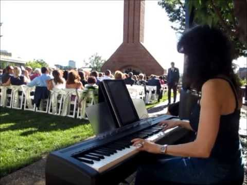 Image Showing A Woman Playing The Grand Digital Piano In A Modern Wedding.